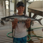 Child holding fish on a charter trip